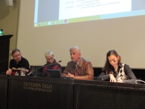 Antonio Cruz (left), interpreter Aino Tuomi-Nikula, Ahmad Yousef and Georgia Bekridaki discussing about solidarity economy and development in the final panel.