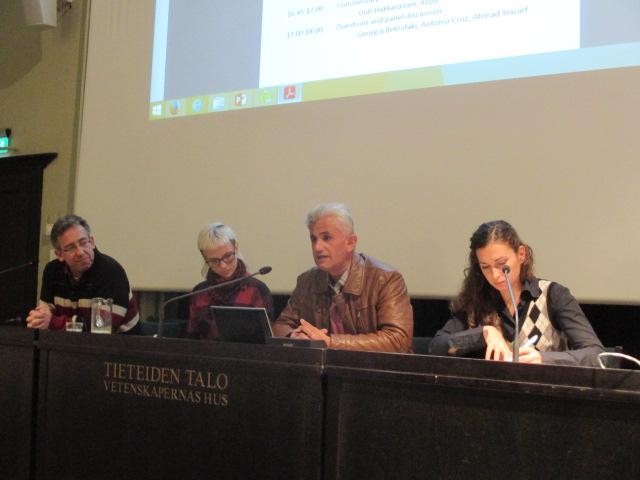 Antonio Cruz (left), interpreter Aino Tuomi-Nikula, Ahmad Yousef and Georgia Bekridaki discussing about solidarity economy and development in the final panel.